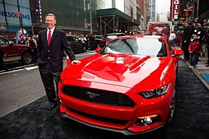 Alan Mulally, CEO of Ford, poses next to the 2015 Ford Mustang on the set of Good Morning America