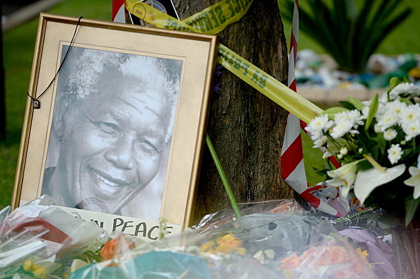 South Africans gather to pay respect and tribute to former President Nelson Mandela outside his Houghton home