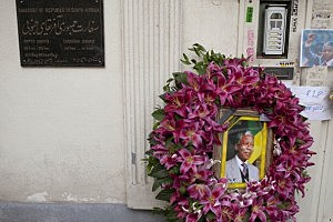 : Mourners gathered in front of the South African embassy to pay their respects to the memory of Nelson Mandela in Tehran, Iran