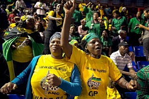 African National Congress members sing and dance during a prayer meeting at the Standard Bank Arena during a national day of prayer for former President Nelson Mandela