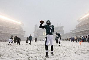 Michael Vick warms up in the snow at Lincoln Financial Field in Philadelphia