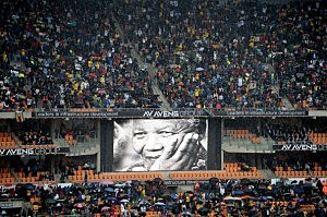 Members of the public attend the Nelson Mandela memorial service at the FNB Stadium in Johannesburg