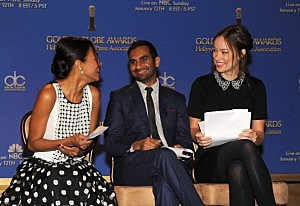 (L-R) Actors Zoe Saldana, Aziz Ansari and Olivia Wilde react onstage at the 71st Golden Globe Awards Nominations Announcement at The Beverly Hilton Hotel