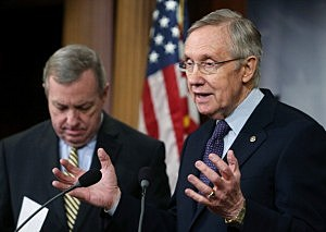 Senate Majority Leader Harry Reid (D-NV) (R) speaks while U.S. Sen. Dick Durbin (D-IL) listens during a news conference on Capitol Hill,