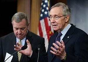 Senate Majority Leader Harry Reid (D-NV) (R) speaks while U.S. Sen. Dick Durbin (D-IL) listens during a news conference on Capitol Hill,
