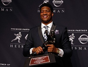 Jameis Winston, quarterback of the Florida State Seminoles, poses with the trophy