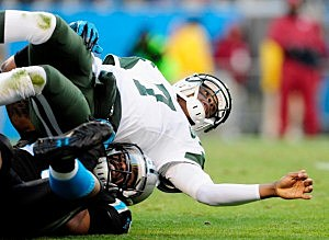Greg Hardy #76 of the Carolina Panthers slams Geno Smith #7 of the New York Jets to the turf