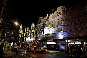 Police and fire crews outside the Apollo Theatre in London after the collapse of a balcony during a performance