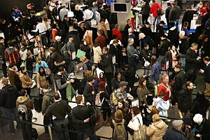 Travelers wait in line for a security check at O'Hare International Airport in Chicago