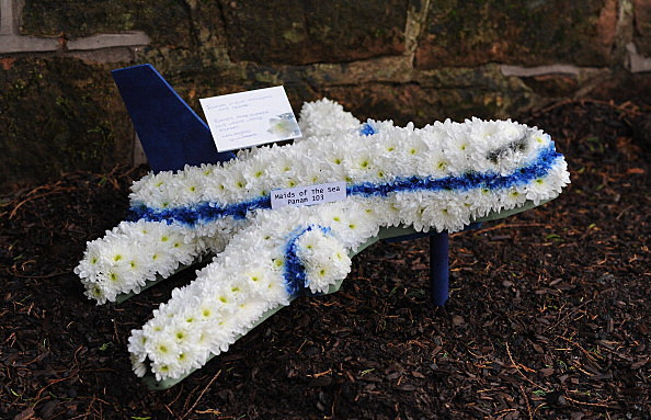 A floral tribute marking the Lockerbie air disaster is left next to the memorial wall in Dryfesdale cemetery on the 25th anniversary of the tragedy