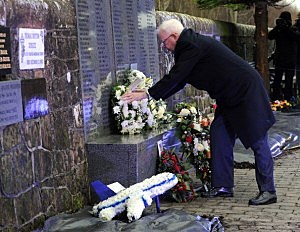 Lord Wallace, the Advocate General of Scotland lays a wreath during the memorial service in Dryfesdale cemetery to commemorate the 25th anniversary of the air disaster in Lockerbie, Scotland