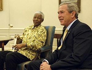 President George W. Bush (R) meets with former President of South Africa, Nelson Mandela, in the Oval Office of the White House May 17, 2005