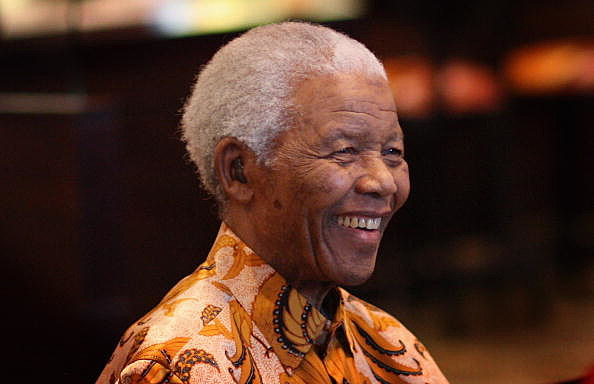 Nelson Mandela smiles during a lunch to Benefit the Mandela Children's Foundation as part of the celebrations of the opening of the new One&Only Cape Town resort on April 3, 2009