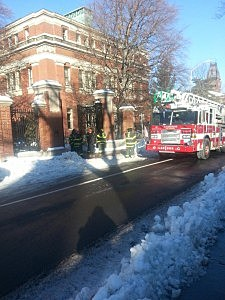 Fire truck in front an evacuated building at Harvard University