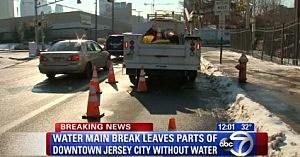 A repair crew works on Jersey City water main break