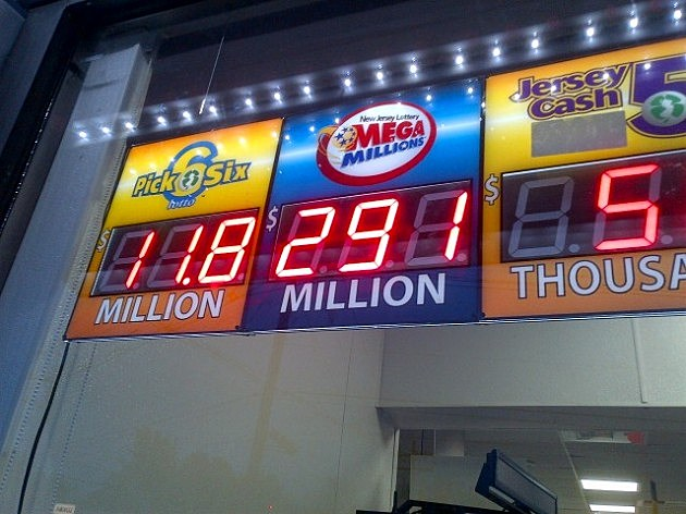 Friday's Mega Millions jackpot is displayed at the 7-11 store in Ewing