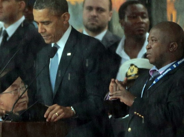 A fake interpreter on stage next to President Obama at the Nelson Mandela memorial service in South Africa