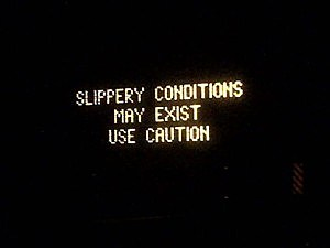 Electronic message board warns of slippery conditions on Interstate 195