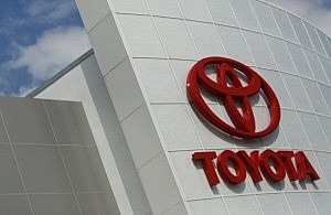 A Toyota sign is seen hanging from a dealership in Florida