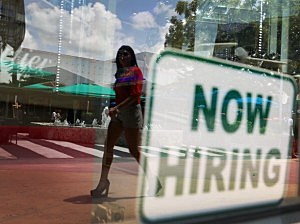 A ''Now Hiring'' sign