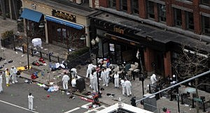 Investigators in white jumpsuits work the crime scene on Boylston Street following Boston Marathon bombing