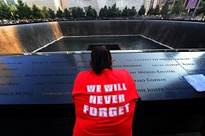 Friends and family members gather at the 9/11 Memorial