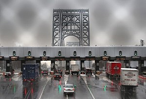 Vehicles slow for tolls before crossing the George Washington Bridge in Fort Lee