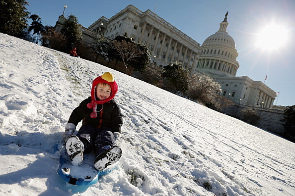 Four-year-old Jack Burger sleds down the hill outside the U.S. Capitol