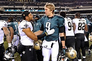 Nick Foles (R) #9 of the Philadelphia Eagles talks with Trevin Wade #30 (L) of the New Orleans Saints after their NFC Wild Card Playoff game at Lincoln Financial Field