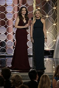 Hosts Tina Fey and Amy Poehler speak onstage during the 71st Annual Golden Globe Award