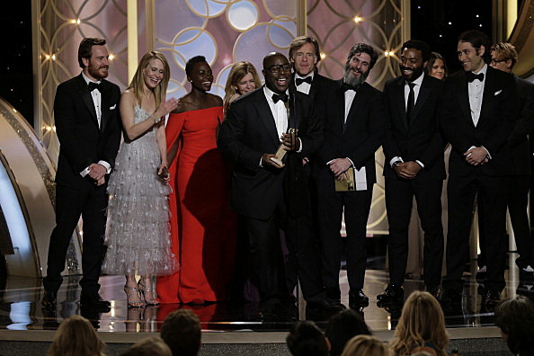 """Steve McQueen and cast accept the award for Best Motion Picture, Drama for """"12 Years a Slave"""" during the 71st Annual Golden Globe Award"""