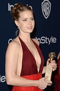 Amy Adams, winner of Best Actress in a Motion Picture - Musical or Comedy for 'American Hustle,' attends the 2014 InStyle and Warner Bros. 71st Annual Golden Globe Awards Post-Party
