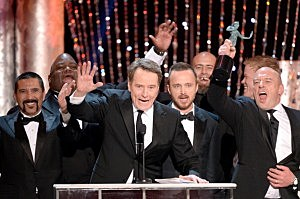 Actor Bryan Cranston (C) accepts the Outstanding Performance by an Ensemble in a Drama Series award for 'Breaking Bad' onstage during the 20th Annual Screen Actors Guild Awards