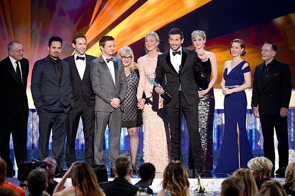 (L-R) Actors Robert De Niro, Michael Pena, Alessandro Nivola, Jeremy Renner, Colleen Camp, Elisabeth Rohm, Bradley Cooper, Jennifer Lawrence, Amy Adams, and Paul Herman accept the Outstanding Performance by a Cast in a Motion Picture award for 'American Hustle' onstage during the 20th Annual Screen Actors Guild Awards