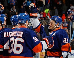 Kyle Okposo #21 of the New York Islanders (R) celebrates the Islanders 4-3 shootout victory over the Philadelphia Flyers