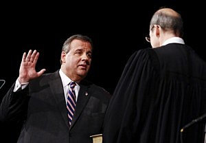 Gov. Chris Christie (L) is sworn in by Chief Justice of the New Jersey Supreme Court Stuart Rabner for his second term