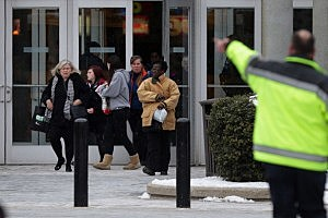 Police evacuate employees and patrons from the Columbia Town Center Mall in Maryland
