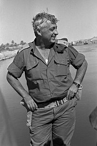 Southern Command General Ariel Sharon stands on the banks of the Suez Canal in the Sinai Desert during the Yom Kippur War October 31, 1973 in Egypt.
