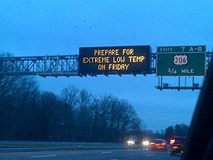 Electronic sign on I-95 warns of bitter cold temperatures on Friday