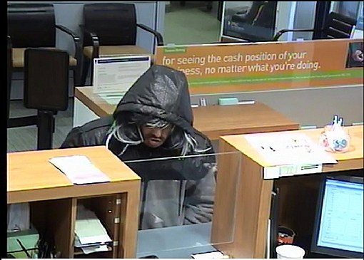 Surveilliance photo of suspect at the robbery of a TD Bank in Brick