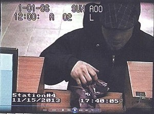 Surveillance photo of suspect at the robbery of a Columbia Bank branch in Edison