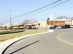 School bues line up outside of Hightstown High School following chemical incident