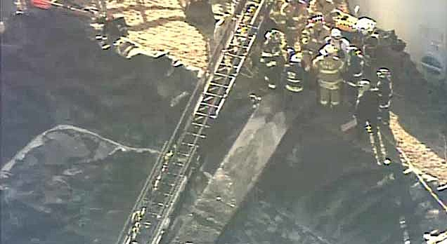 Rescue crews at a United Water facility in Manalapan where a man became stuck in a pipe