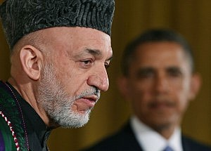 U.S. President Barack Obama (R) and Afghan President Hamid Karzai speak to the media during a joint news conference in the East Room of the White House January 11, 2013