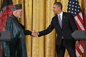 Afghanistan President Hamid Karzai (L) and U.S. President Barack Obama shake hands after a joint news conference in the East Room of the White House January 11, 2013