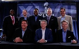 (back row) Shannon Sharpe, Bill Cower, James Brown, Boomer Esiason, Jim Nantz- (front row) Dan Marino, Sean McManus and Phil Simms