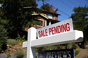 A sale pending sign is posted in front of a home in California