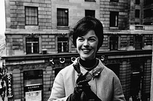 Film star Shirley Temple Black on a visit to London in 1965.