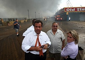 Governor Chris Christie (L) tours the Seaside Heights boardwalk fire area with Deputy Chief of Staff Bridget Anne Kelly (R),