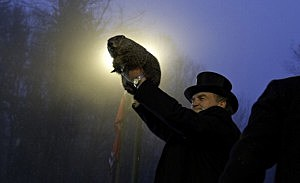 Groundhog handler John Griffiths holds Punxsutawney Phil after he saw his shadow predicting six more weeks of winter during 128th annual Groundhog Day festivities